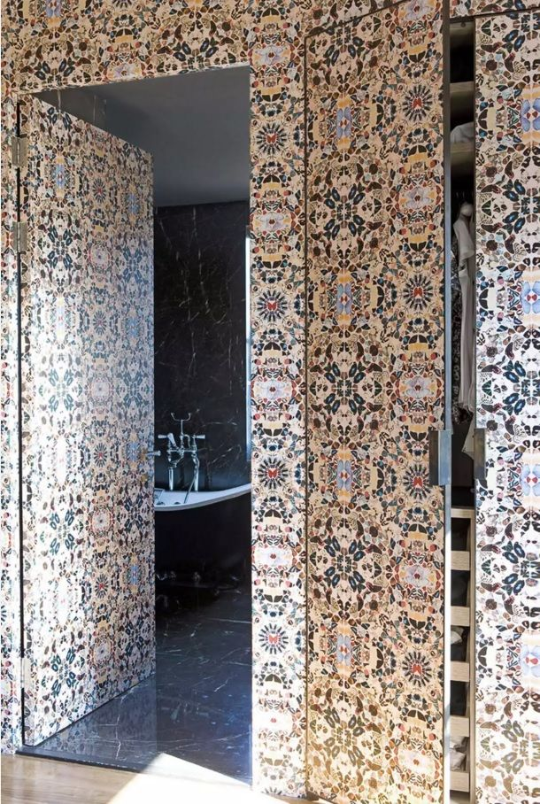 Nice mosaic trimmed wall have the hidden door to the classic styled bathroom