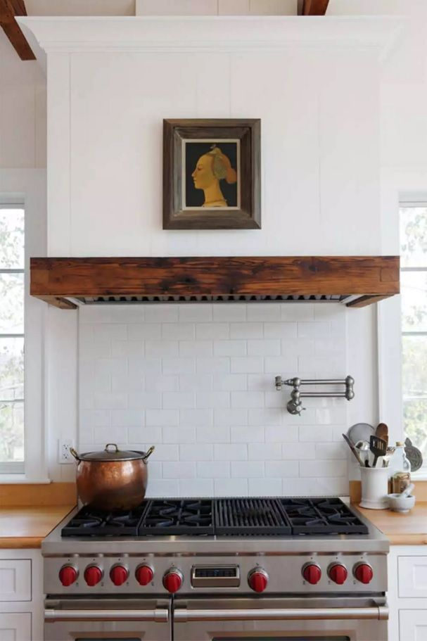 The Main Types of Kitchen Hoods. Photo Gallery and Description. Medeiterranean style with built-in hood with wooden edges