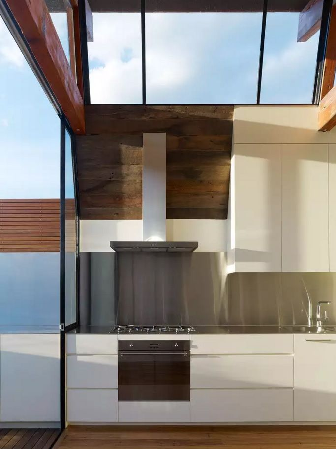 The Main Types of Kitchen Hoods. Photo Gallery and Description. Flat high t-shaped hood made of steel in the contemporary styled space