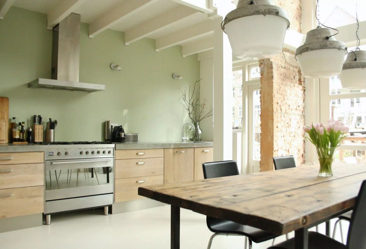 Tender pistachio walls and the open ceiling beams in the spacious room
