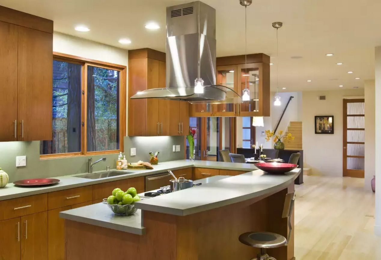The Main Types of Kitchen Hoods. Photo Gallery and Description. Steel glossy island hood in the center of the premise became the accent