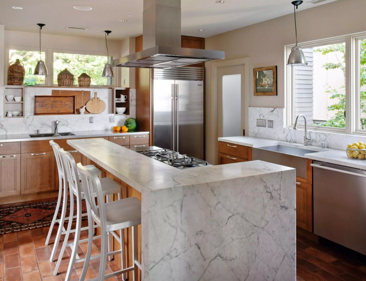 The Main Types of Kitchen Hoods. Photo Gallery and Description. Marble island and the steel hood are perfectly blend