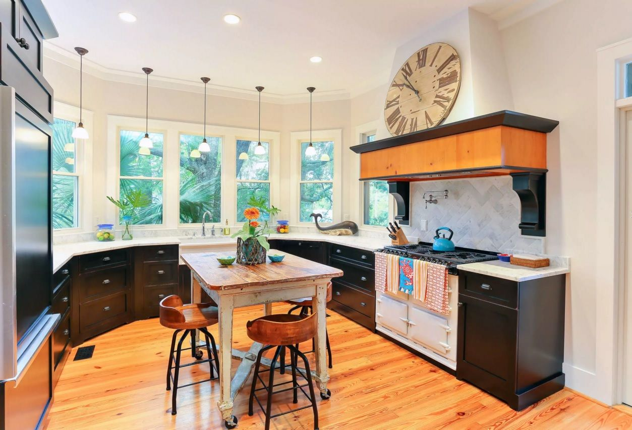 The Main Types of Kitchen Hoods. Photo Gallery and Description. Original decor with the natural materials and small sining zone in center