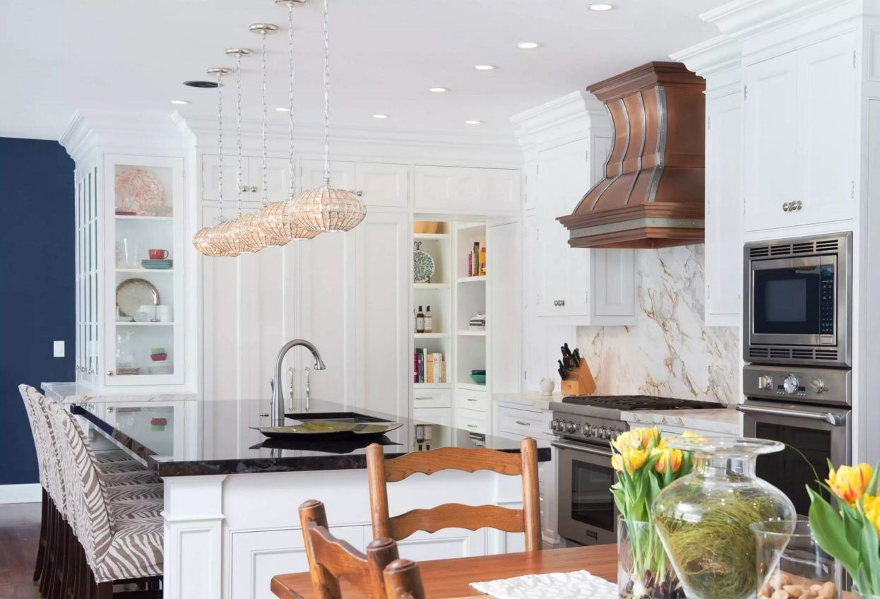 The Main Types of Kitchen Hoods. Photo Gallery and Description. Bright design of the space with the clear dark accents