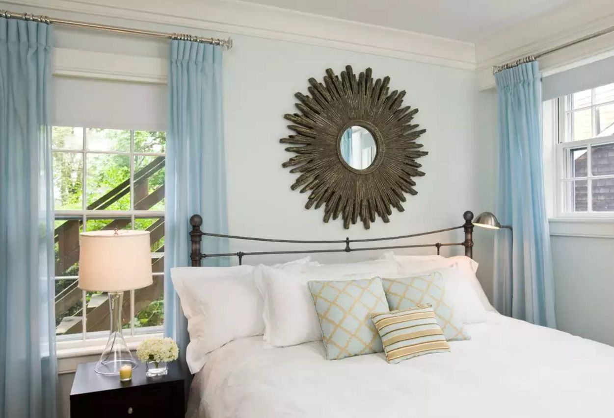 Small Bedroom Decoration Trends Photo. Helio-formed mirror as an accentual spot in the calm interior