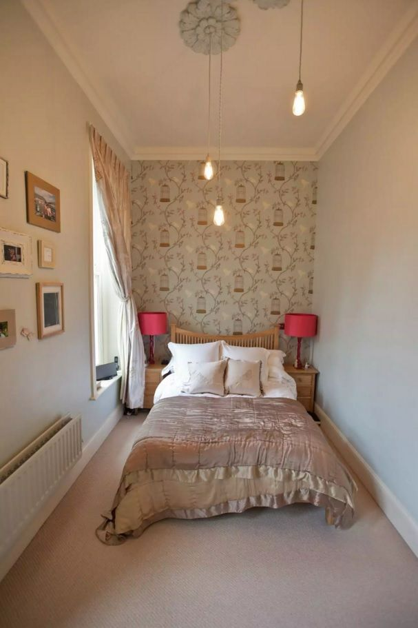 Small Bedroom Decoration Trends Photo. Red lamp shades create intimacy in the white pastel trimmed space