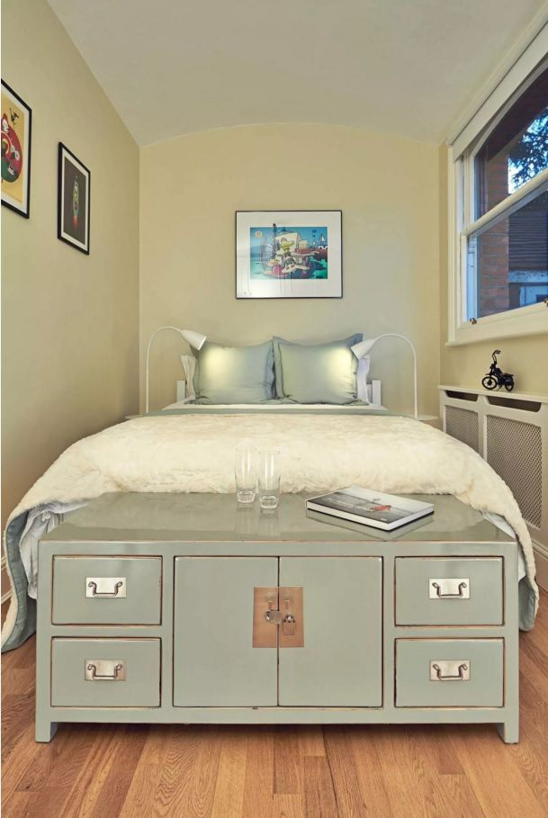 Small Bedroom Decoration Trends Photo. Silver plated silk for pillows and pastel colors create calm perception of the atmosphere