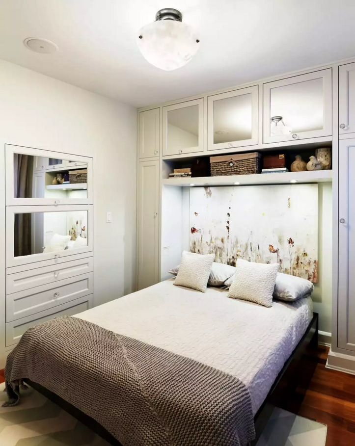 Small Bedroom Decoration Trends Photo. Functional space with painted headboard of the double bed