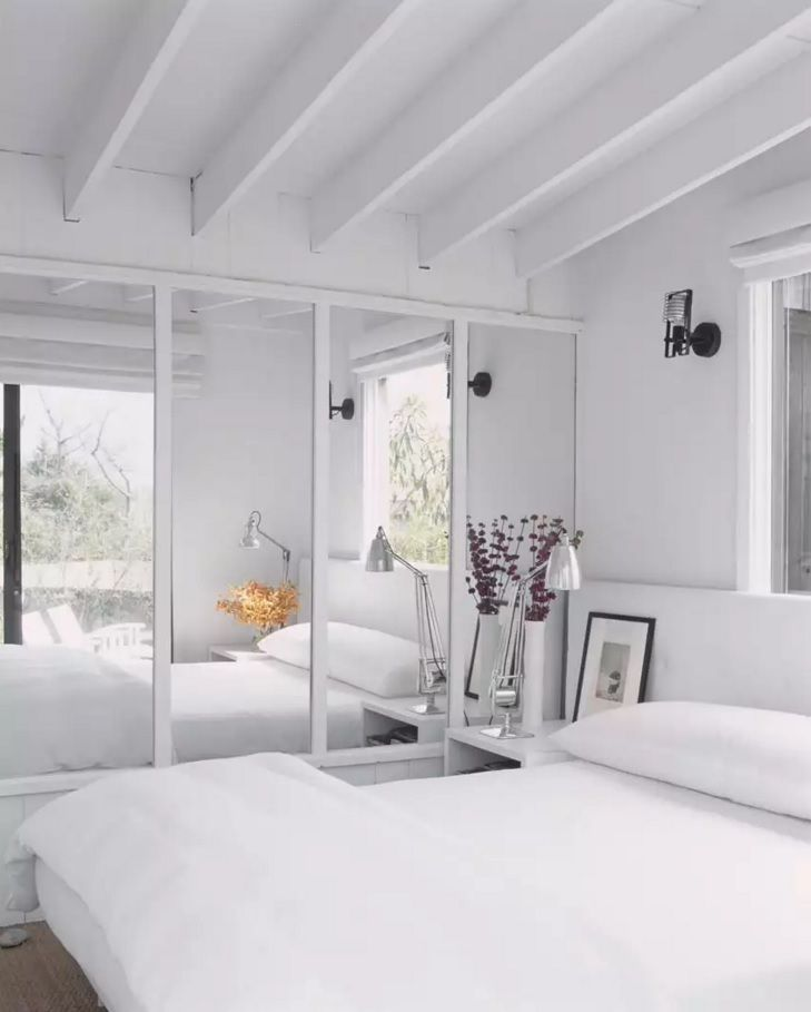 Small Bedroom Decoration Trends Photo. Gorgeous austere design in total white with mirror surface of the cabinet
