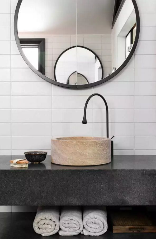 Bathroom Tap and Sink Ideas as an Interior Decoration Elements. Unusual design of the black vaulted tap and round bowl