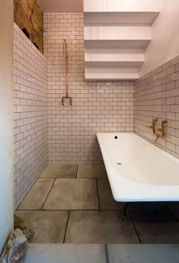 Minimalistic design of the sanitary ware in the bathroom with metro tiles