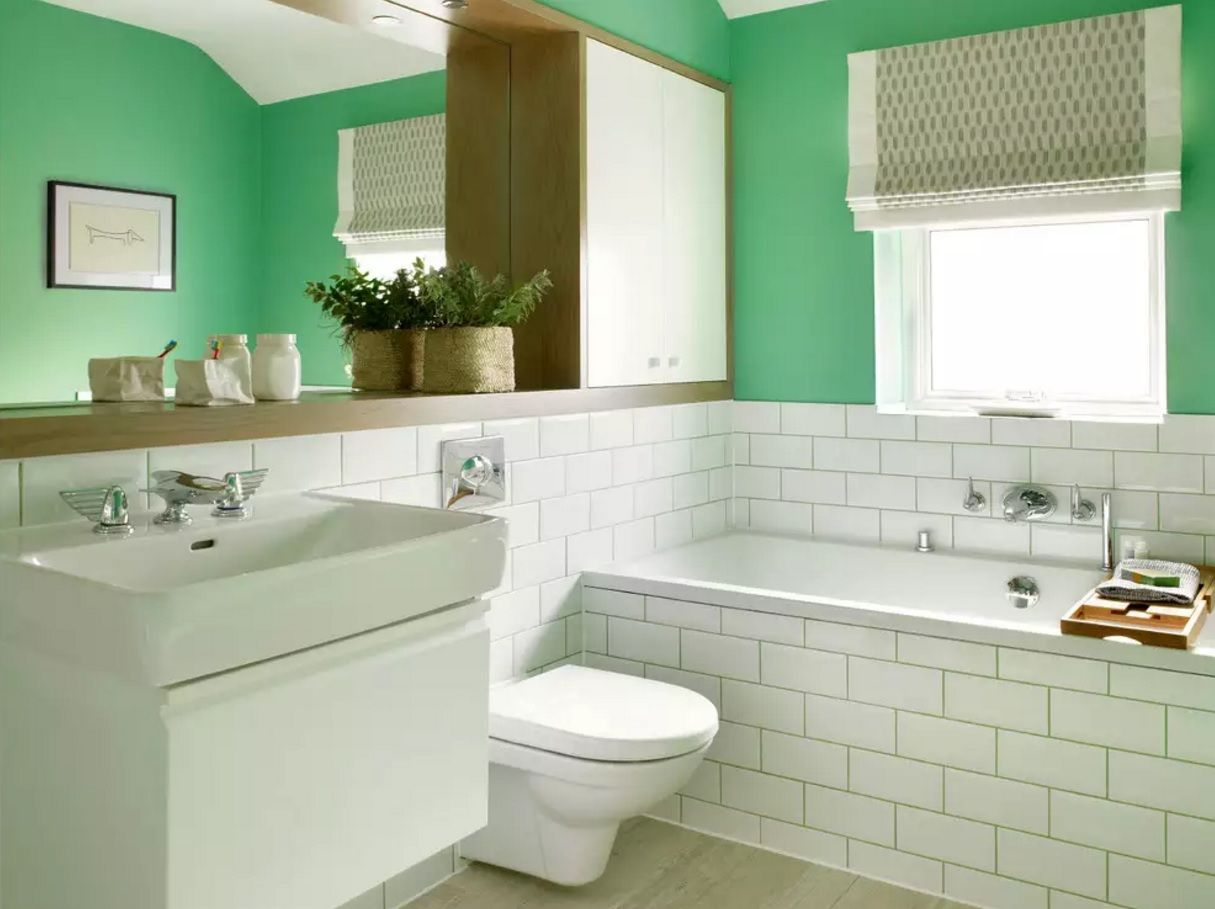 Unusual decoration combination of bright green with white tile in the minimalistic tyled bathroom