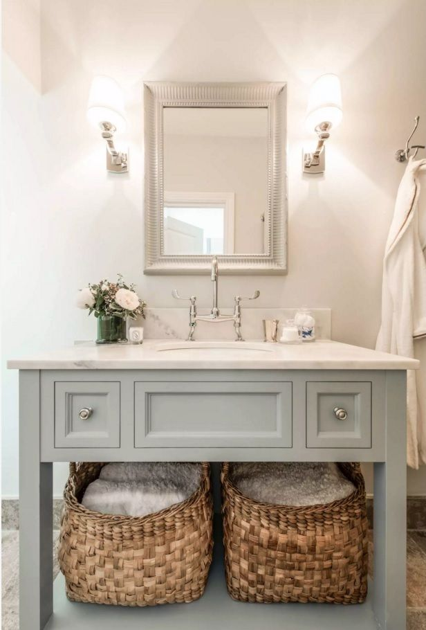 Classic vanity and austere decoration in the bathroom with vintage tap