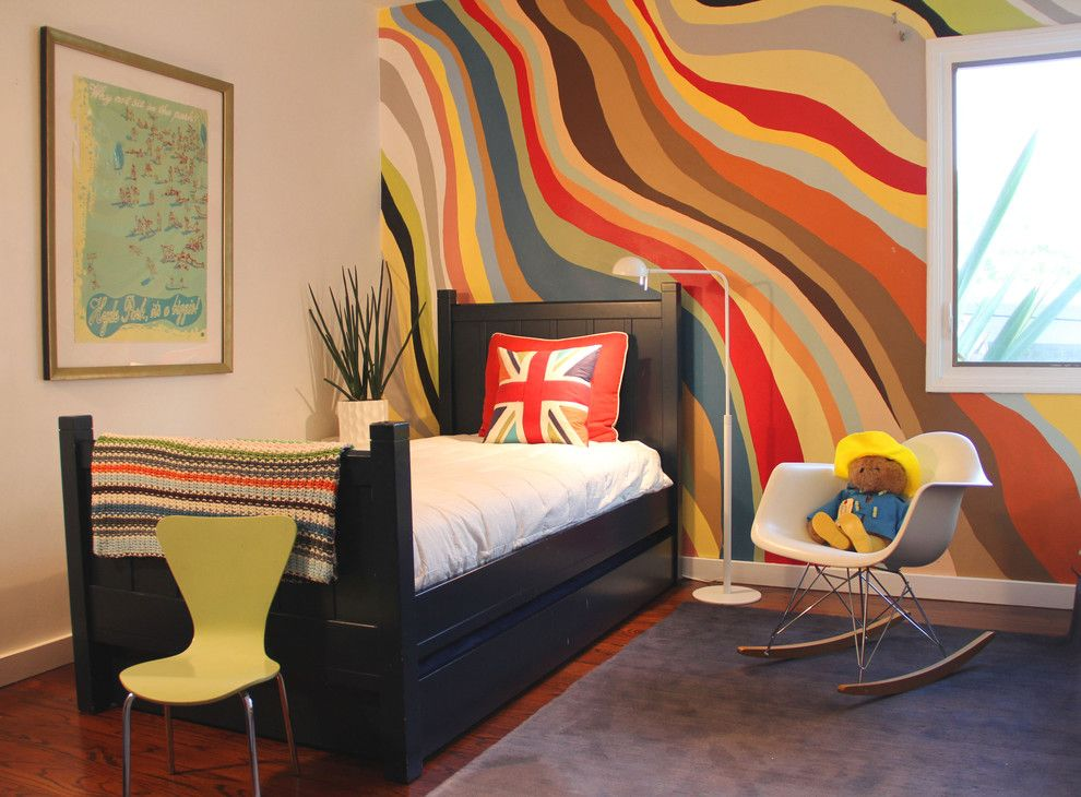 Wall painted in gradient of bright colors in the fresh designed bedroom