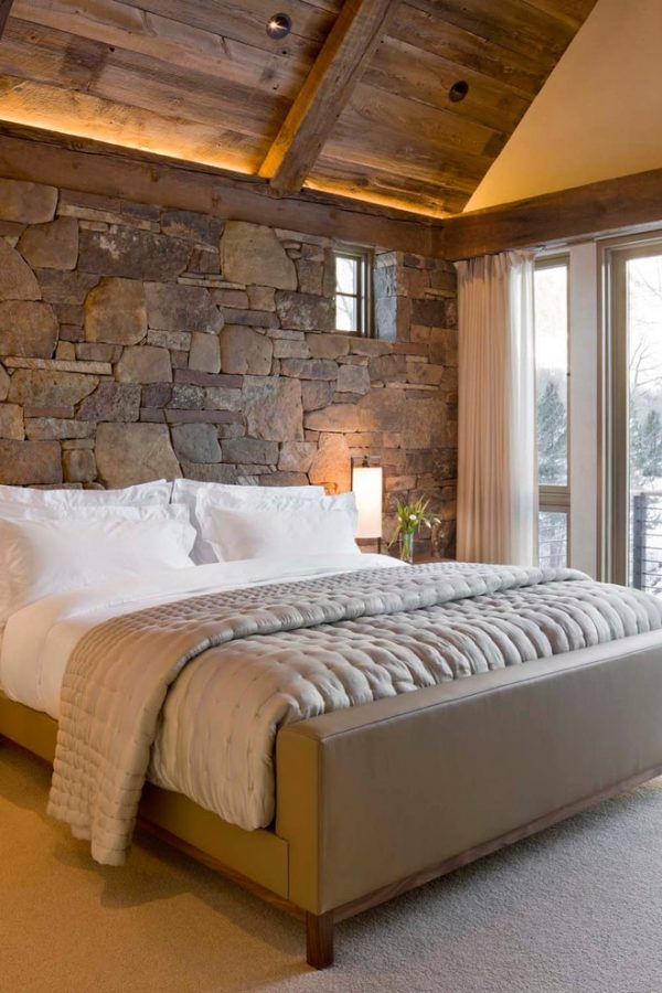 Stone decorated headboard in the bedroom