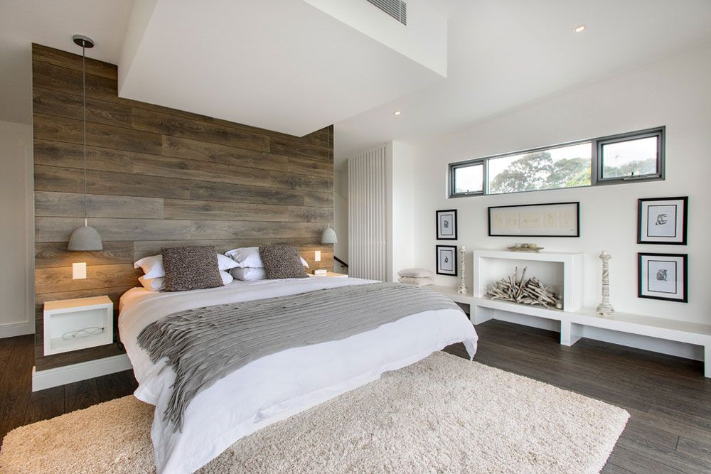 Contemporary bright design of the bedroom with plasterboard zoning