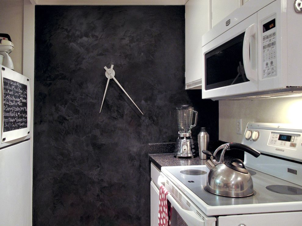 Top 7 Most Popular Materials for Wall Finishing. Original design of the clock for the contemporary small kitchen with dark accent wall
