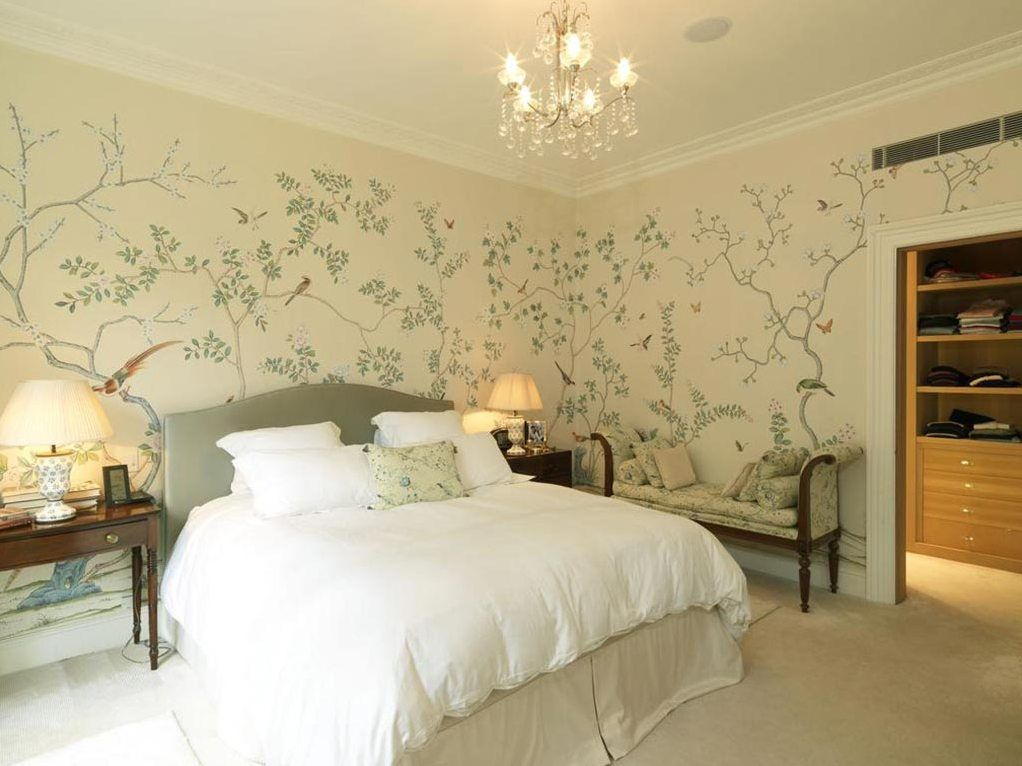 Naturalistic pattern of the wallpaper in the light decorated bedroom