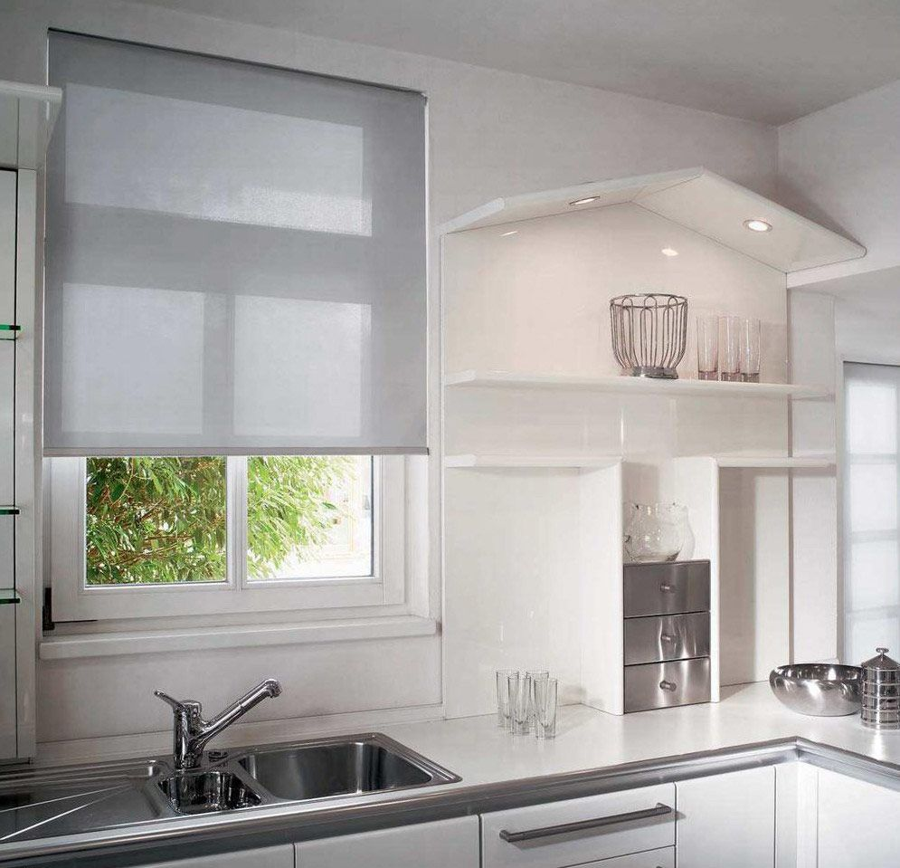 Nice mini blinds in the bright hi-tech kitchen interior