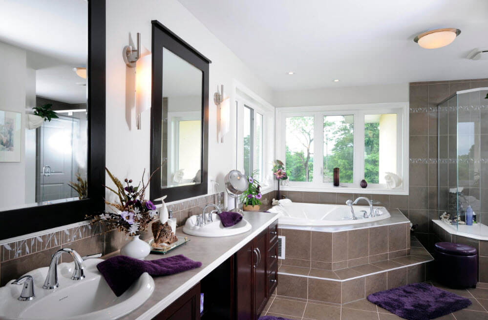 Tiled baords of jacuzzi tub and panoramic wide windows for the nicely designed bathroom