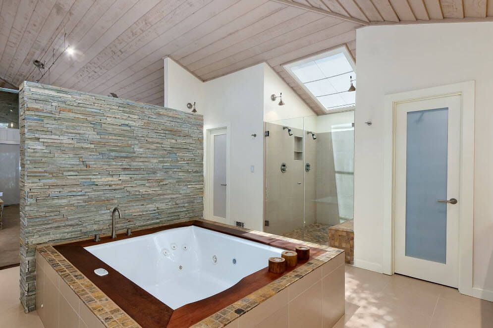 Nice design composition in a large bathroom of complex mix of styles trimmed with natural materials
