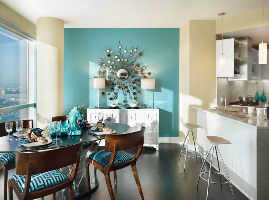 Turquoise accent wall with decorative panel