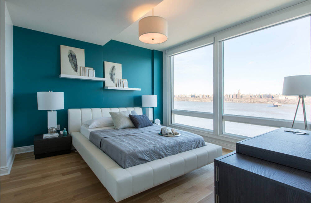 Turquoise accent wall in the apartment near the seashore