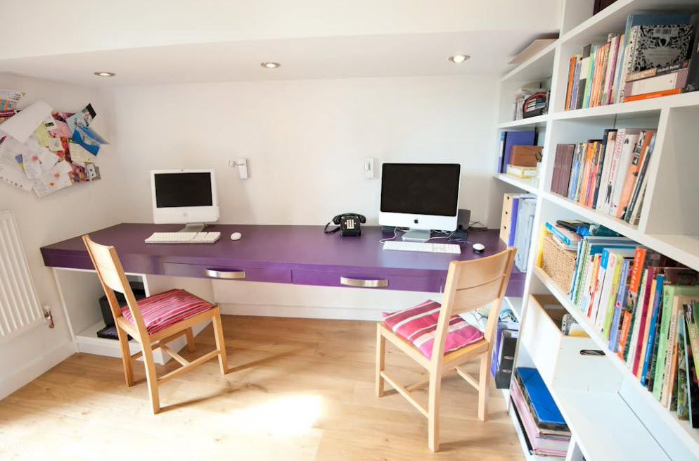Apple macbooks to help young pupils learn in the white room with purple table top