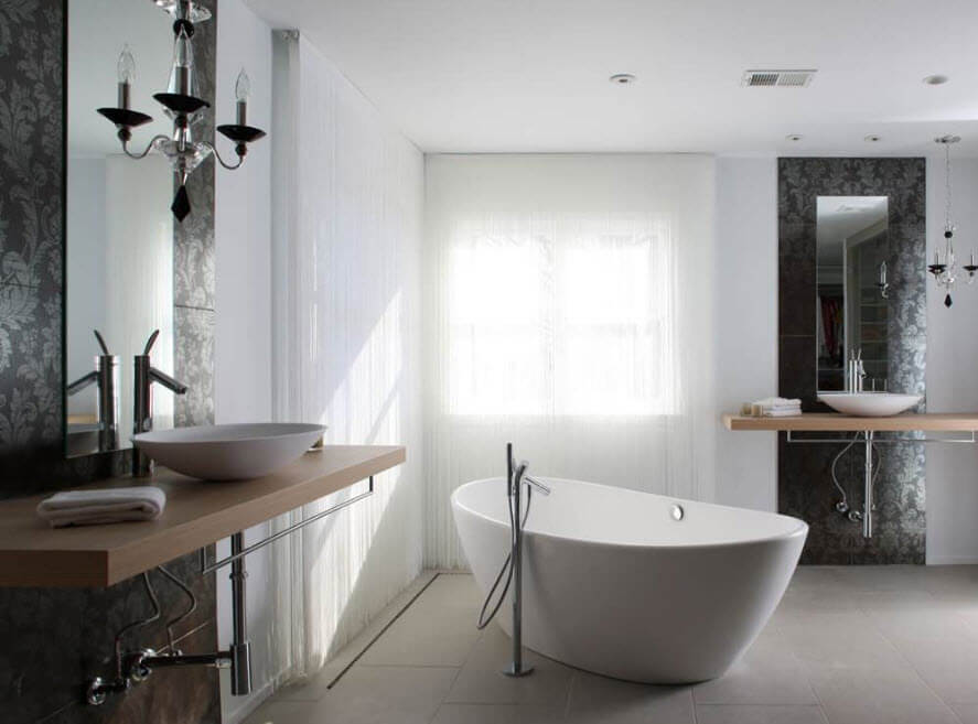 Modern design of the central acrylic bathtub with the round steel tap