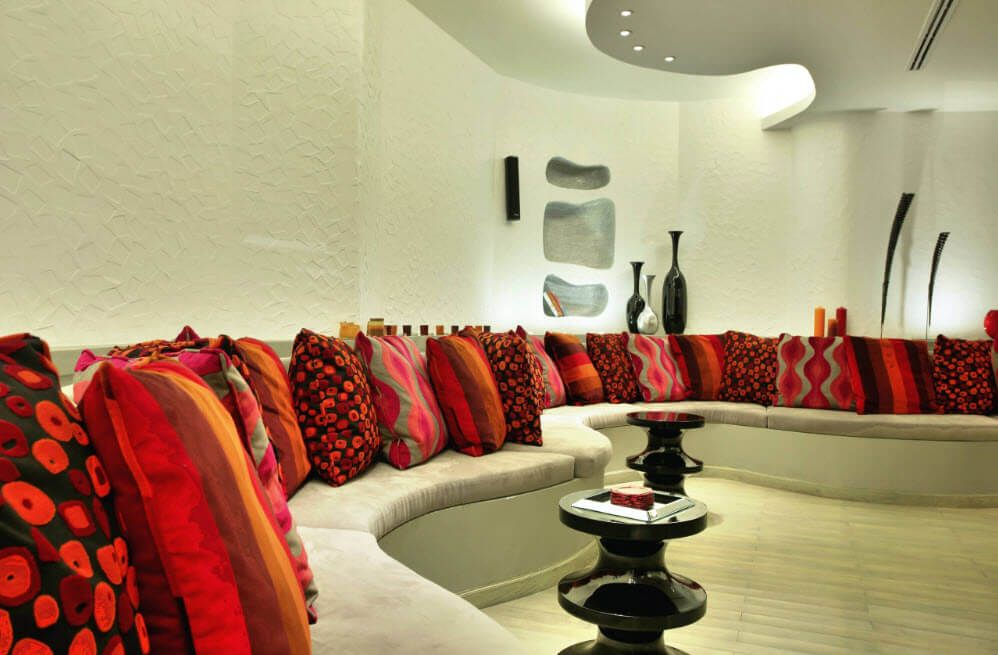 A real paradise of colorful cushions in the large curved living room
