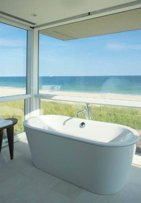 Snow white bathroom with panoramic view at the seaside house
