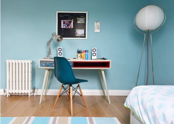 Creative interior design for the boys room with painted blue walls and furnished in modern style