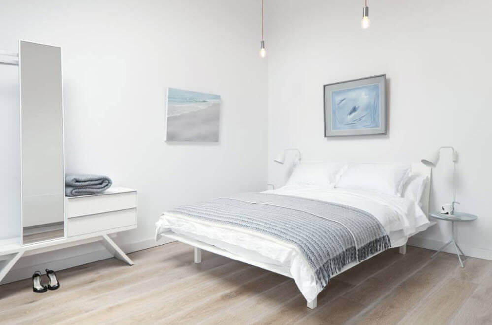Modern Style Bedroom - Cozy Minimalism. White calming atmosphere of the sleeper