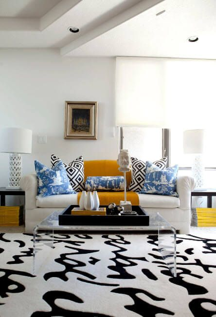 Zebra rug at the classic stylized living room with a lot of decorative elements