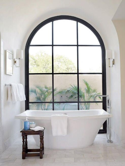 White tub at the arched bay window