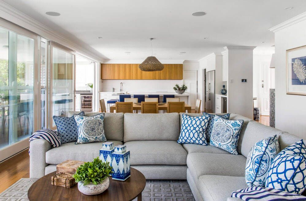 A little bit nautical theme in the large studio apartment with lots of pillows of blue pattern