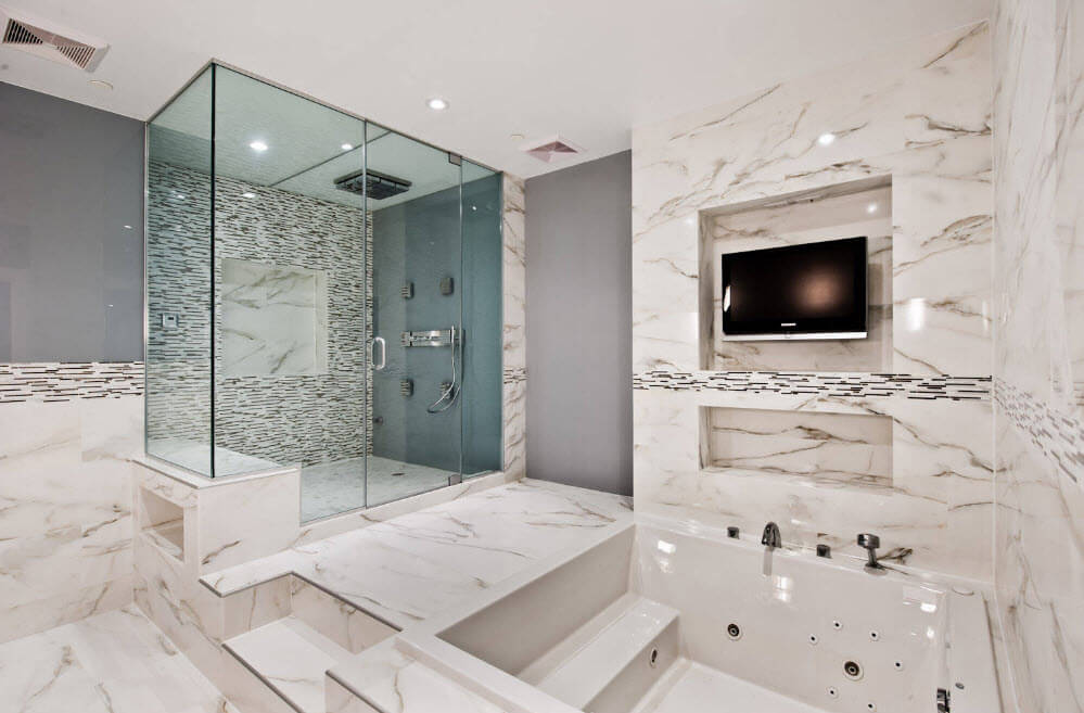 Jacuzzi Bathtubs Description, Photos, Design Ideas  . Nice light marble with patina and clear veins for wall trimming and even LED TV to fit the interior of the bathroom