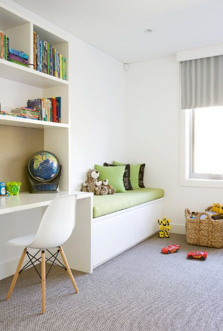 White room for the young schoolboy with low multifunctional bed at the window