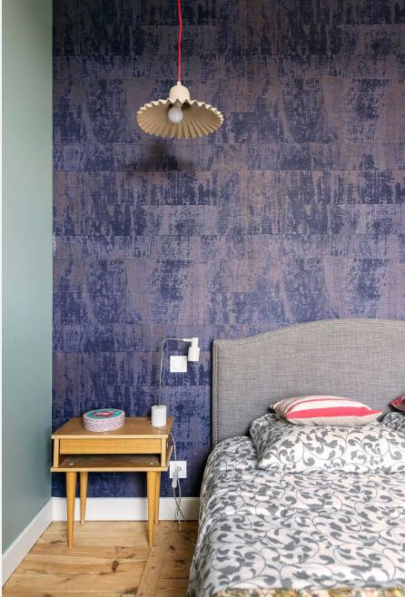 Purple accent wall with impressionistic theme and the cozy Scandinavian style furniture