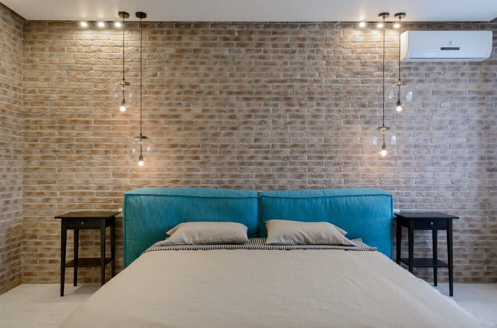 Brickwork as an accent wall finishing idea for industrial bedroom