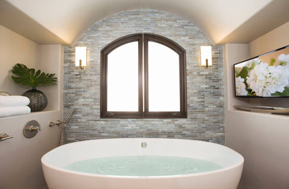Gray stone trimmed room and the arched bathroom design