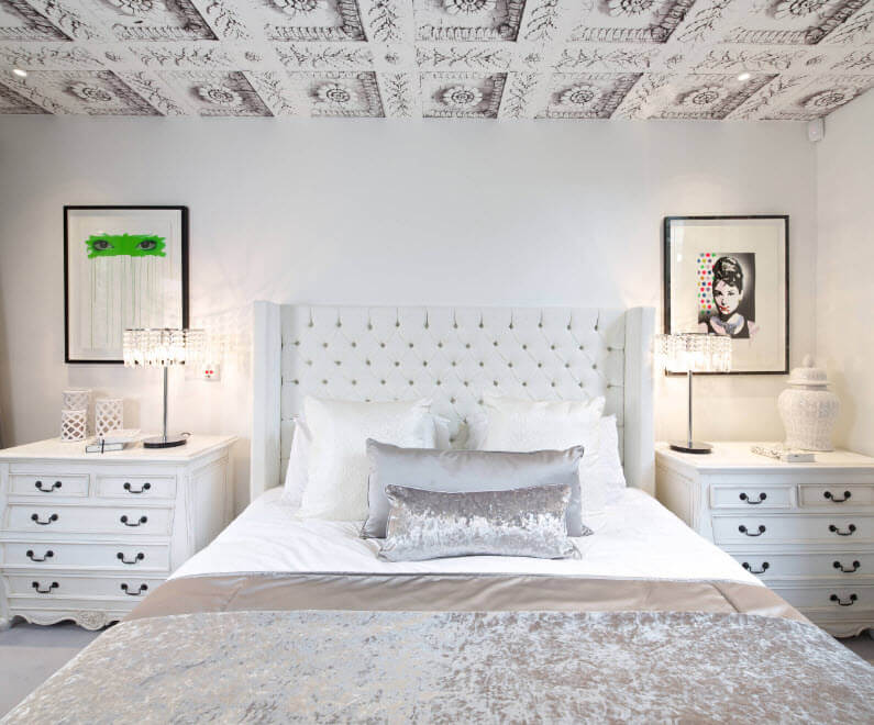 bedroom interior with light ceiling panels silmualting classic fretwork