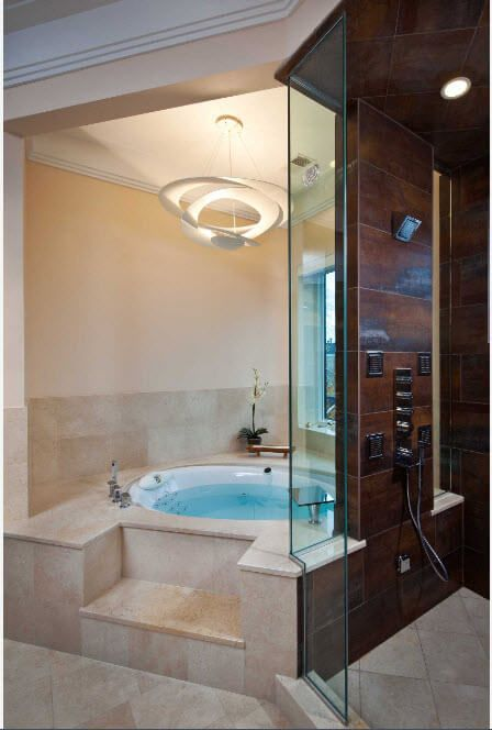 Jacuzzi Bathtubs Description, Photos, Design Ideas. Noble modern design idea for the natural materials decorated large bathroom with standing hydromassage system
