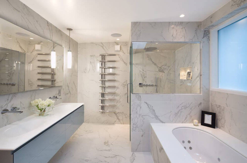 Ultramodern marble trimmed interior of the bathroom with hovering vanity and jacuzzi for two