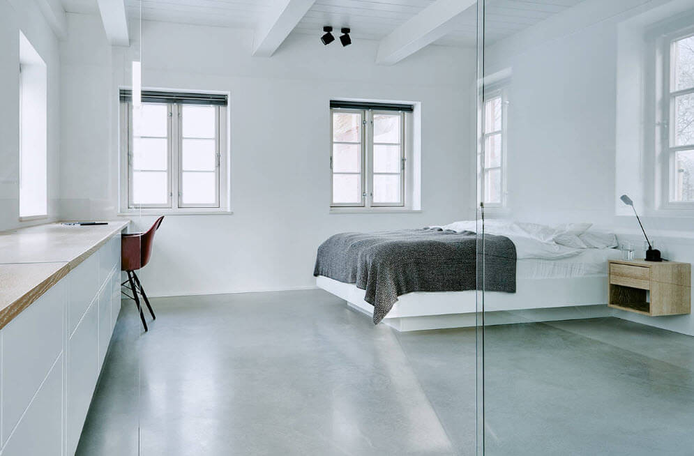 White glossy surfaces and gray floor for the great minimalistic industrial design of the bedroom