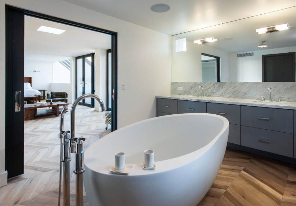 Laminated floor and acrylic tub in large bathroom
