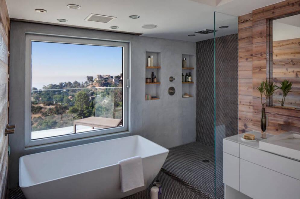 Private house bathroom with a bathtub near panoramic window