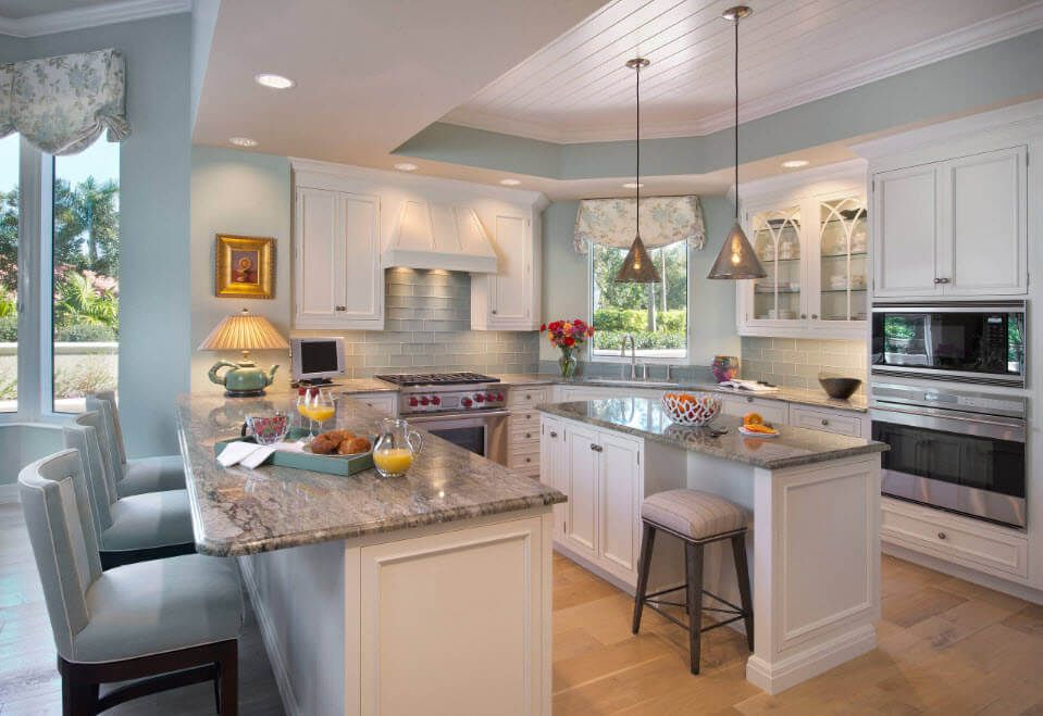 White kitchen furniture facades and granite countertop within Mediterranean style