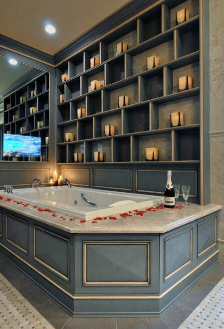 Unique ultiamtely romantic atmosphere in the bathroom with shelving and Jacuzzi
