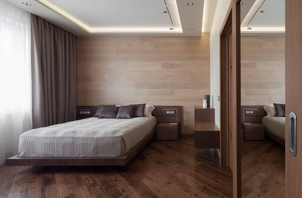Effective ceiling perimeter backlight for the romantic atmosphere in the bedroom with wooden trimming